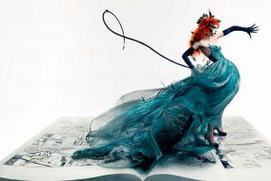 Coco Rocha Blue Dress On A Book And Red Hair