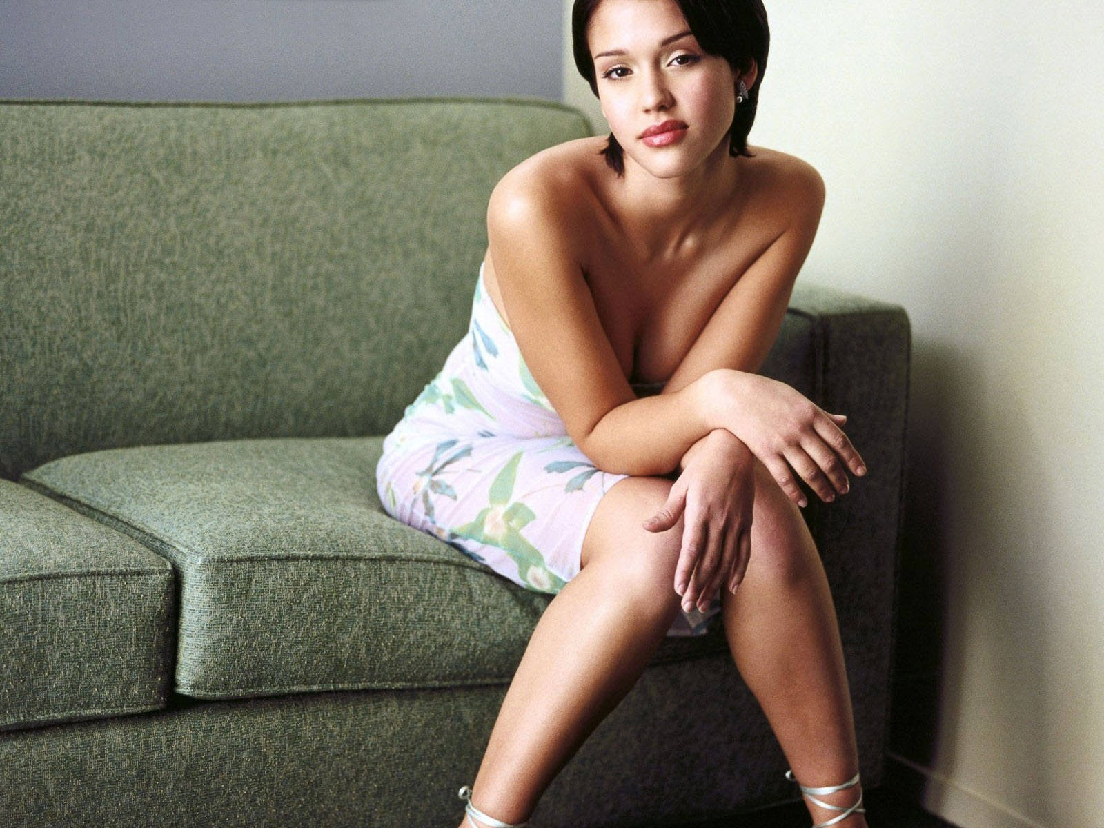 Jessica Alba Sitting Down On Green Bed