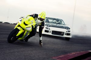 Moto vs Sport Car Racing