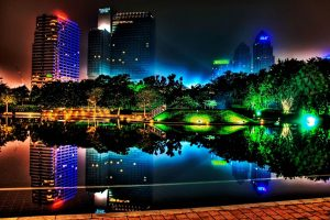 Neon City Lights Reflecting In The Water Wide