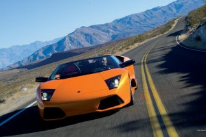 Orange Lamborghini On The Road Wide