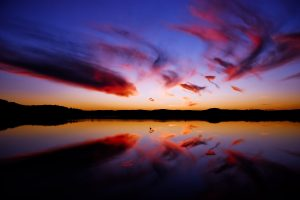 Red Clouds Reflected In Water Wide