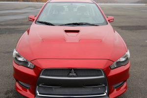 Red Mitsubishi Evo X Front View