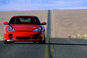 Red Porsche GT2 On The Road