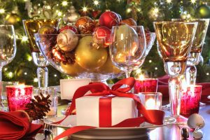 Elegant Holiday Table Setting With Red Rib boned Gift