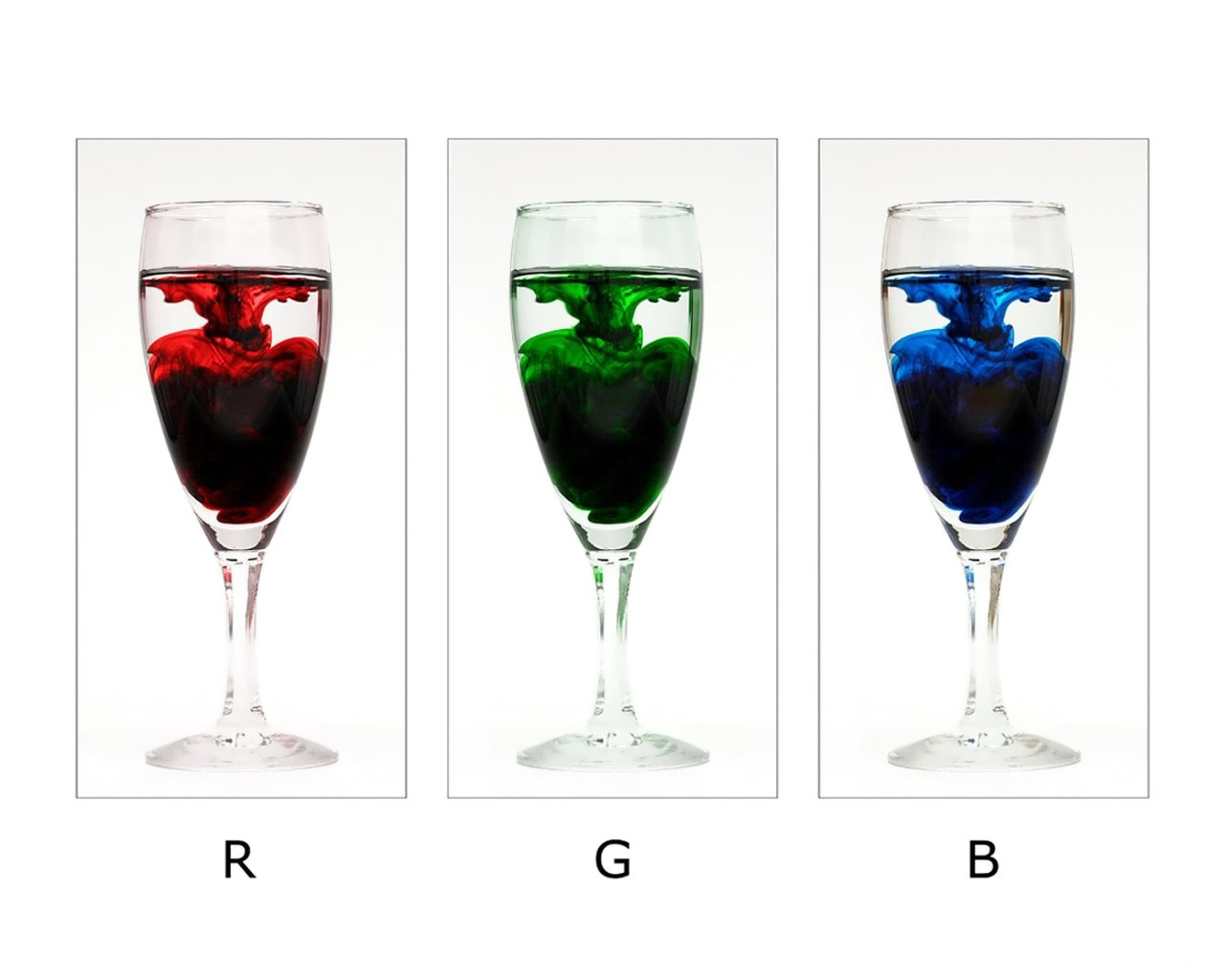 Three Glasses Filled With Red Green And Blue