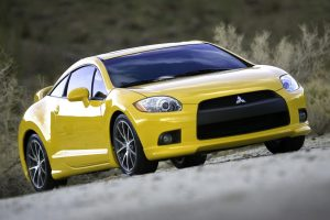 Yellow Mitsubishi Eclipse GT 2009 Front Wide