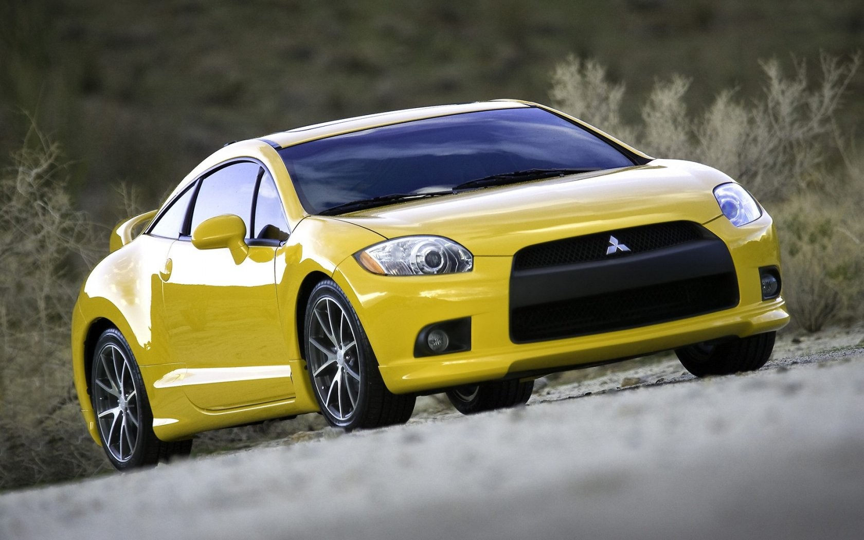Yellow Mistubishi Eclipse Gt 2009 Front Wide